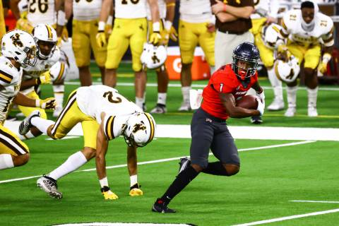 UNLV Rebels wide receiver Kyle Williams (1) runs the ball against the Wyoming Cowboys during th ...