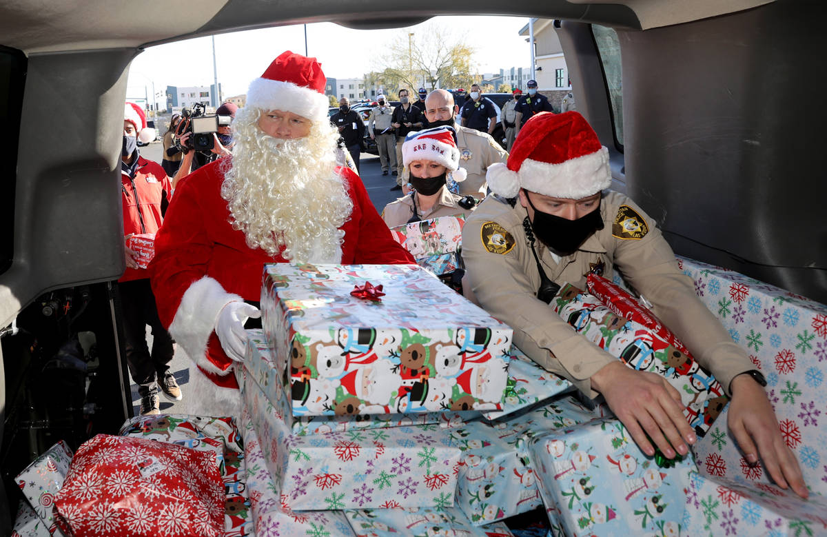 Las Vegas police officers, including Mike Sian, right, A. Karas and Santa prepare for their San ...