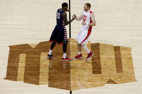 Alex Davis, left, of Fresno State and Alex Kirk of New Mexico shake hands while standing on the ...