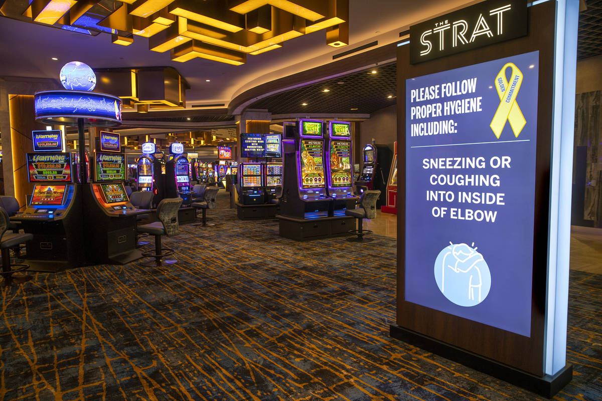 A hygiene reminder greets potential guests on the casino floor at the Strat on Wednesday, Dec. ...