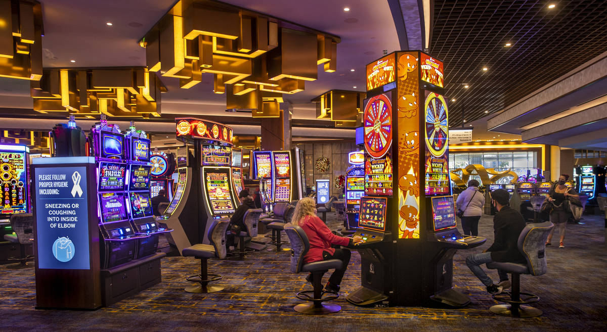 A few slot machines are being played on the casino floor at the Strat on Wednesday, Dec. 23, 20 ...