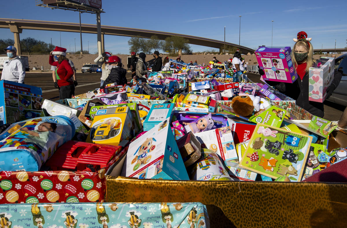 Boxes of toys for all kidÕs ages are ready to be given out by volunteers as the Las Vegas ...