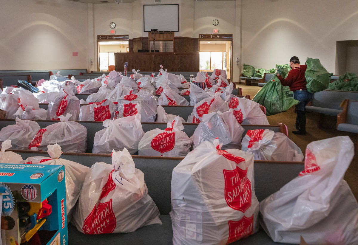 Individual Christmas gifts are organized for each household are seen waiting to be picked up at ...