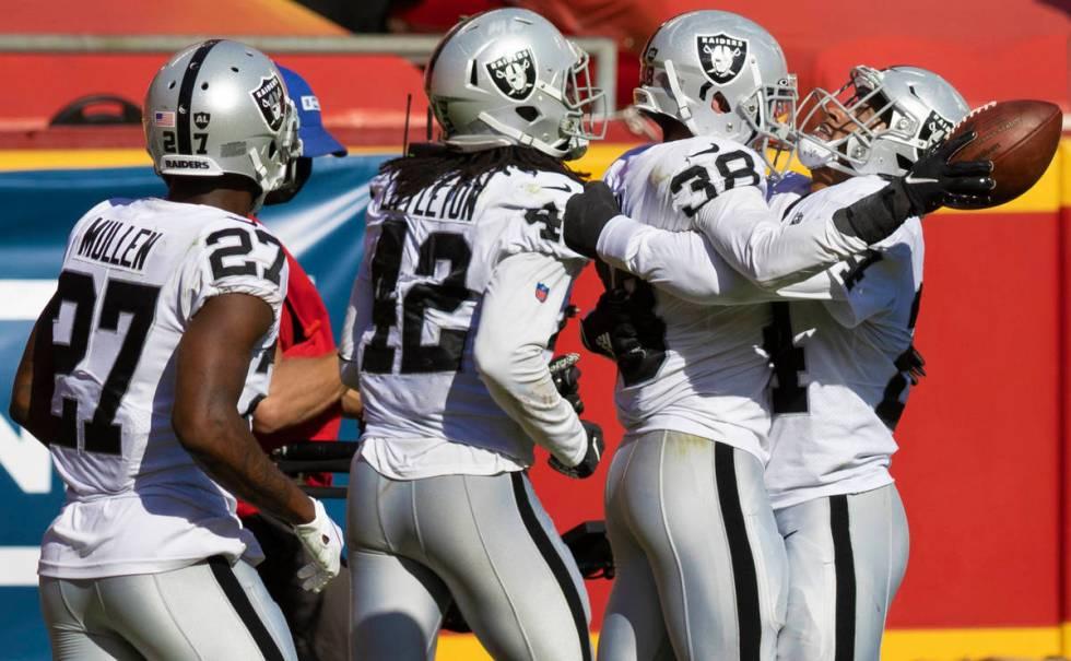 Las Vegas Raiders strong safety Jeff Heath (38) celebrates with Las Vegas Raiders cornerback Tr ...