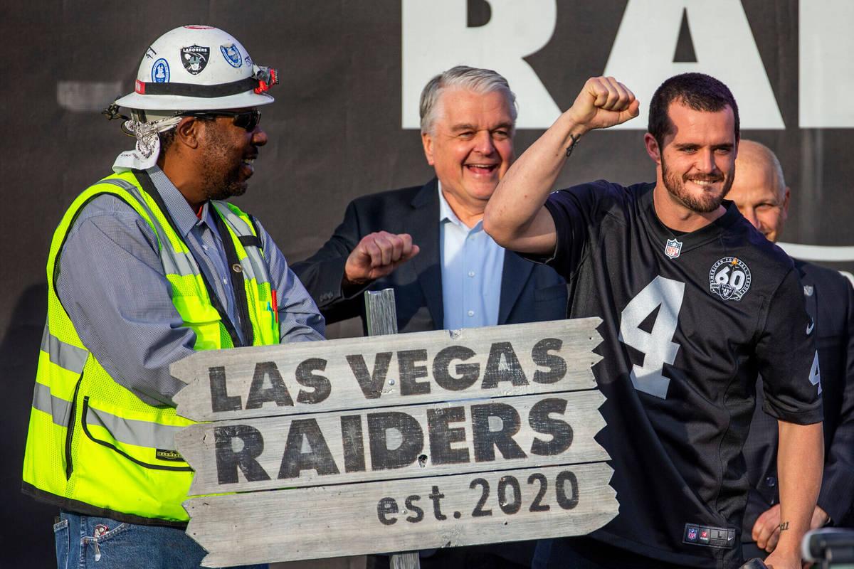 Las Vegas Raiders quarterback Derek Carr (4, center) pump a fist to the crowd after hammering a ...