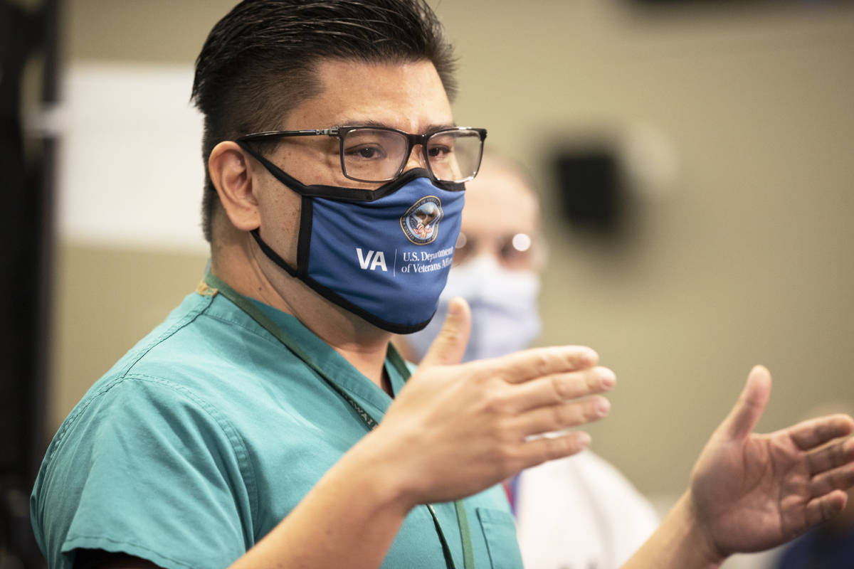 Dr. Myron Kung discusses the COVID-19 vaccine at the North Las Vegas VA Medical Center on Wedne ...