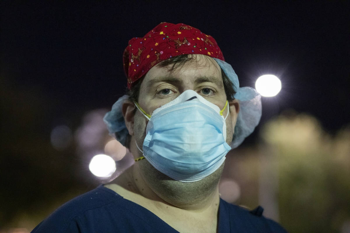 Zachary Pritchett, an intensive care nurse at St. Rose Dominican Hospital, Siena Campus, is see ...