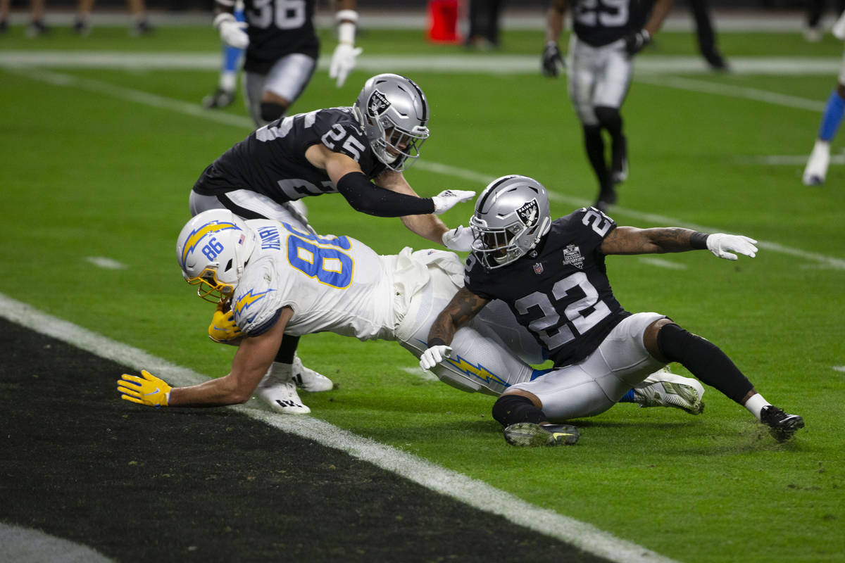 Los Angeles Chargers tight end Hunter Henry (86) dives into the end zone past Raiders free safe ...