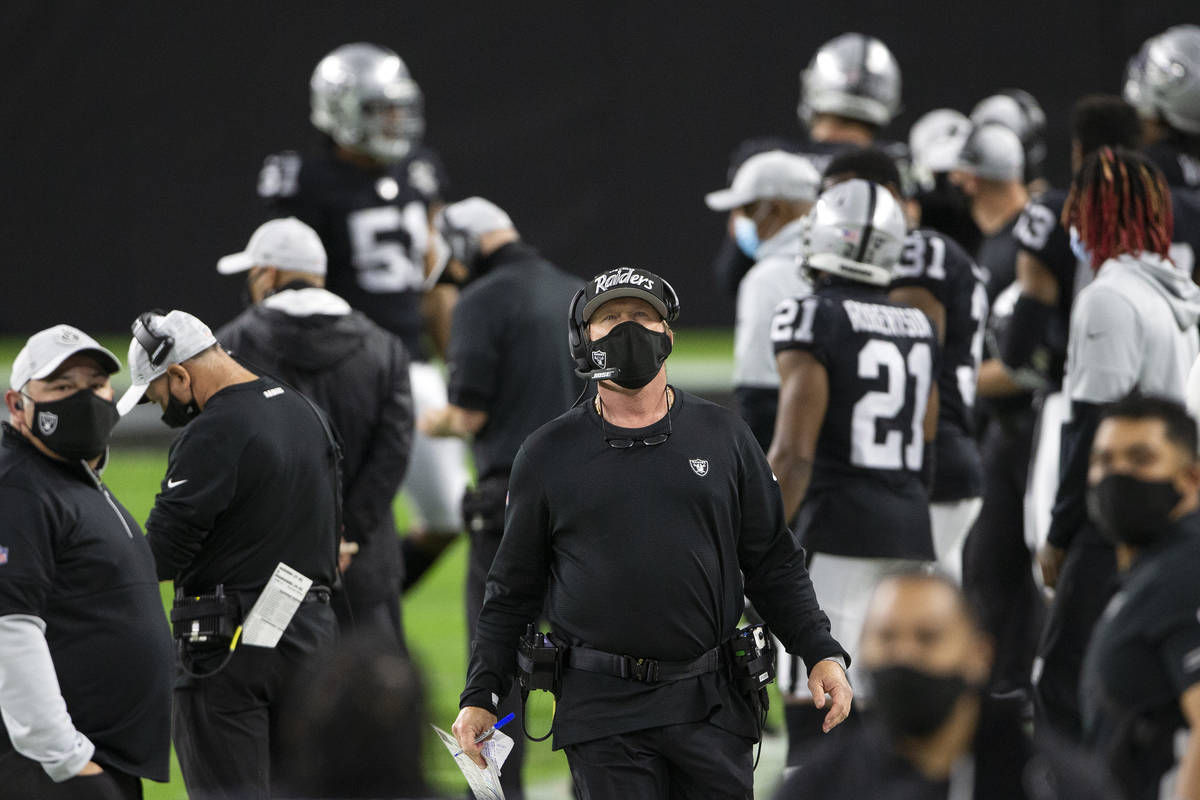 Raiders Head Coach Jon Gruden looks up at the score board in the second quarter during an NFL f ...