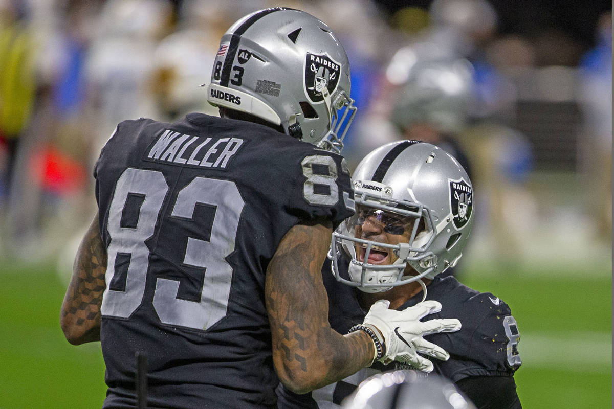 Raiders tight end Darren Waller (83) celebrates his touchdown with quarterback Marcus Mariota ( ...