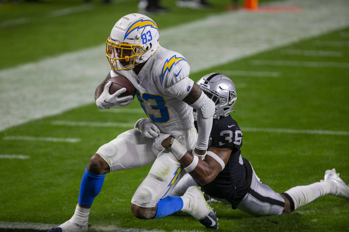 Los Angeles Chargers wide receiver Tyron Johnson (83) scores a touchdown as Raiders cornerback ...