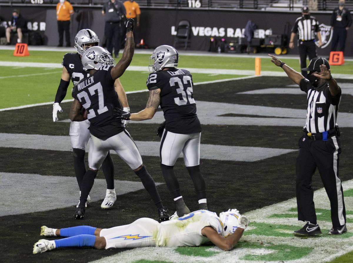 Raiders cornerback Trayvon Mullen (27) celebrates with Raiders safety Dallin Leavitt (32) after ...