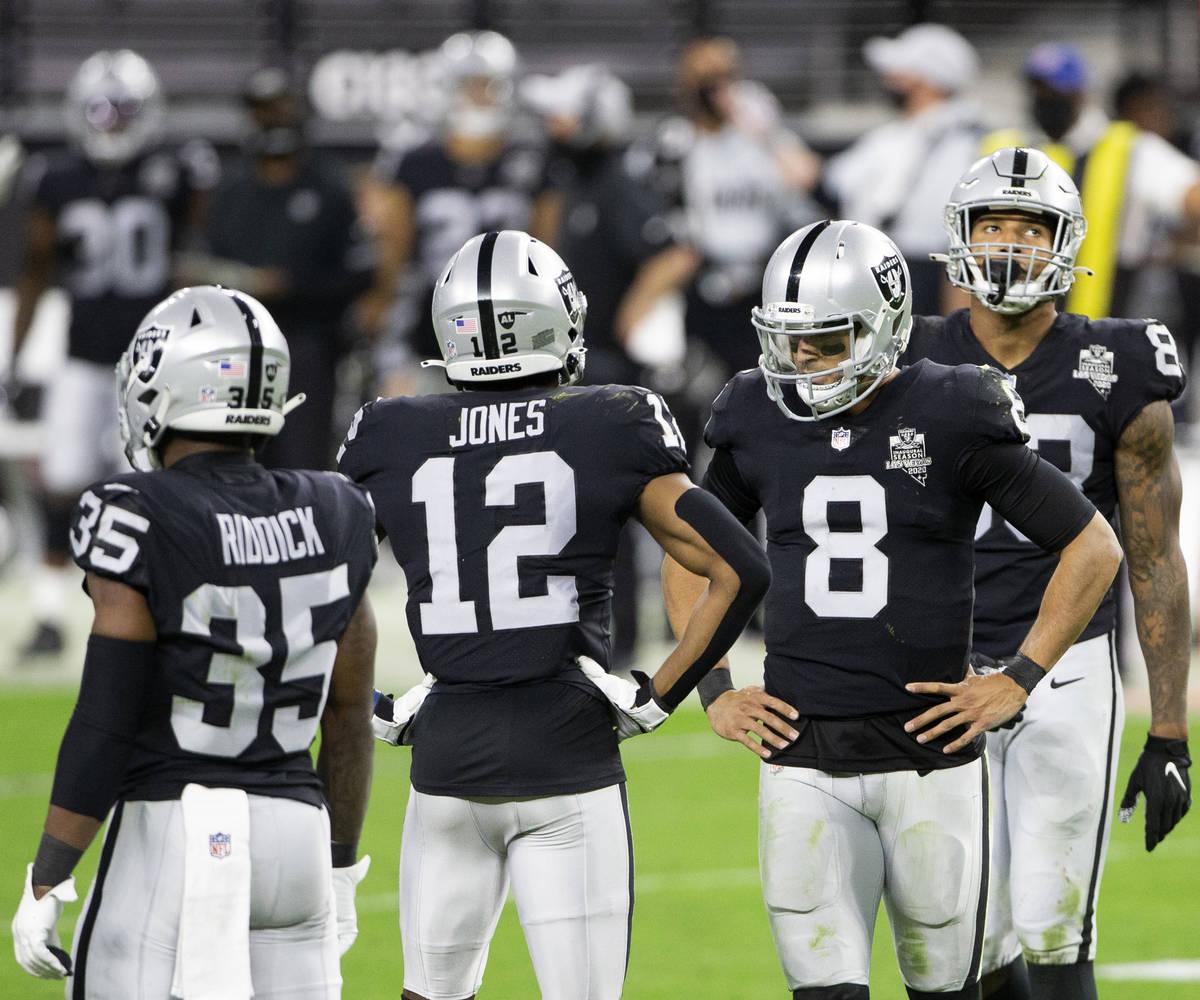 Raiders running back Theo Riddick (35), wide receiver Zay Jones (12), quarterback Marcus Mariot ...