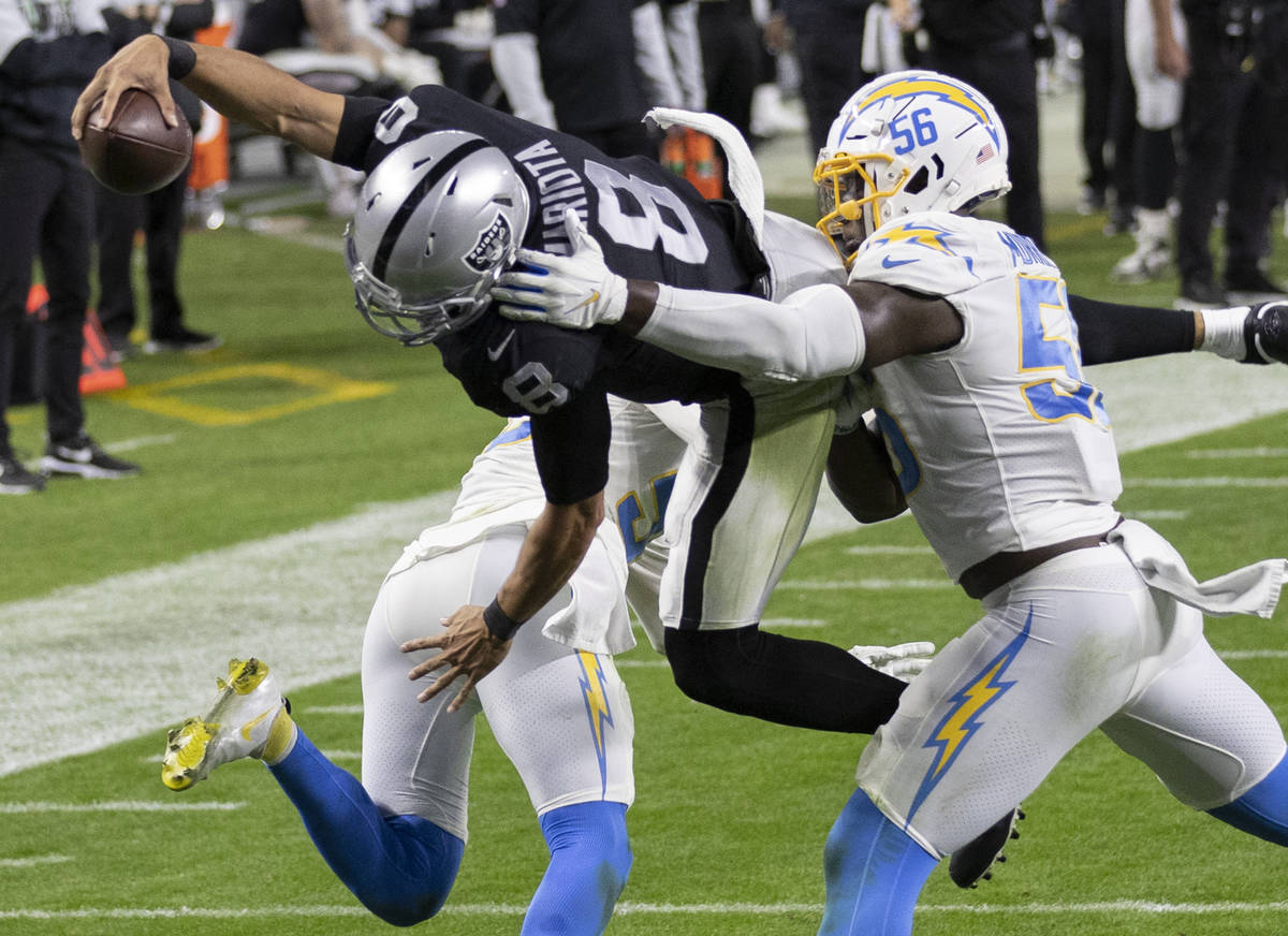 Raiders wide receiver Siaosi Mariner (9) leaps over Los Angeles Chargers outside linebacker Ken ...