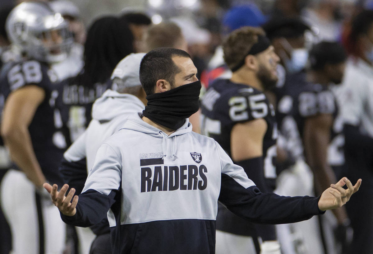Raiders quarterback Derek Carr puts his hands up in frustration in the fourth quarter during an ...