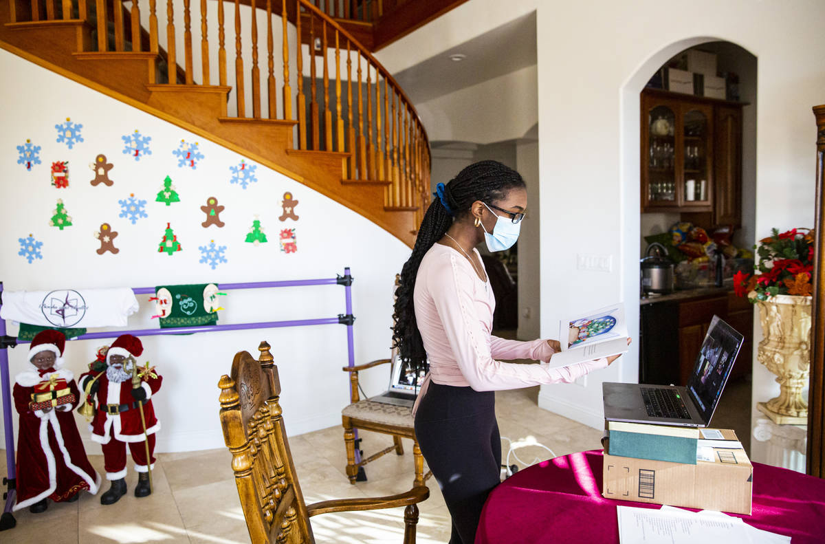 Dre Boyd-Weatherly, a junior at Valley High School, leads a Books and Ballet class from her hom ...