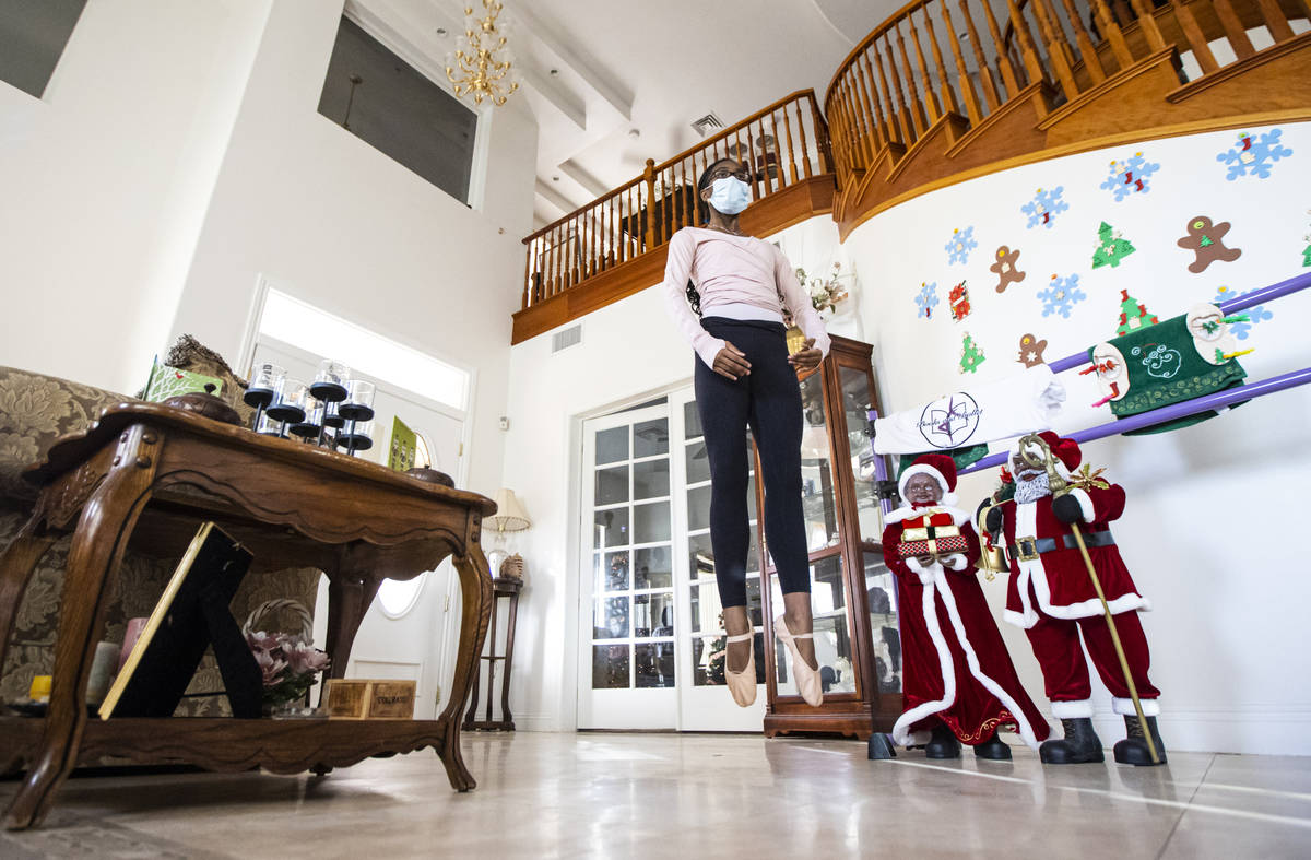 Dre Boyd-Weatherly, a junior at Valley High School, leaps into the air while leading a Books an ...