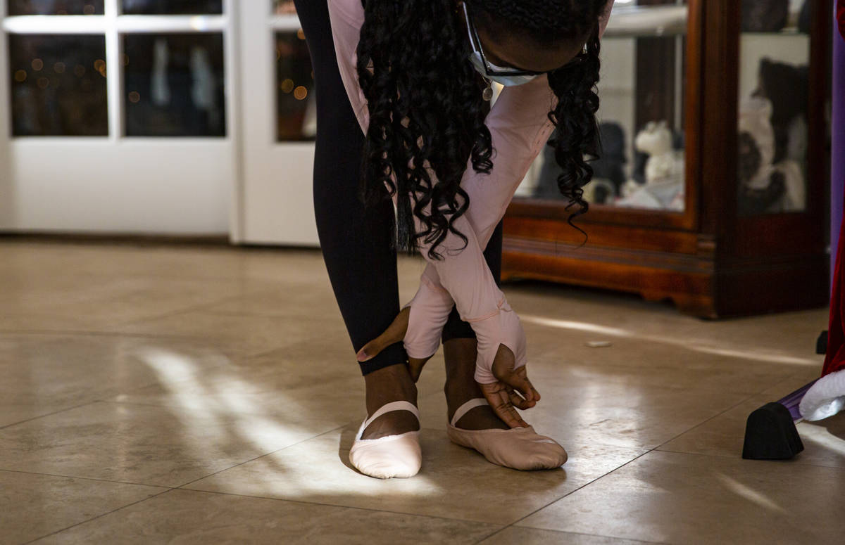 Dre Boyd-Weatherly, a junior at Valley High School, stretches during a Books and Ballet class f ...