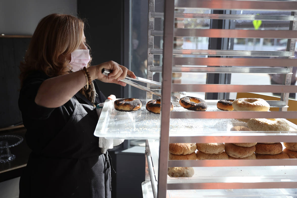 Sonia El-Nawal, owner of Bodega Bagel, organizes bagels at Vegas Test Kitchen in Las Vegas on S ...