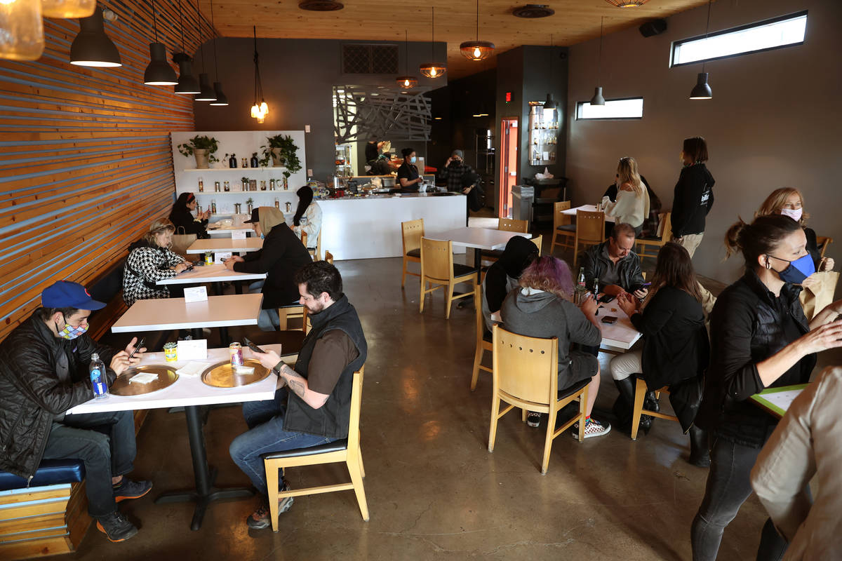 People dine at Vegas Test Kitchen in Las Vegas on Saturday, Dec. 12, 2020. (Erik Verduzco / Las ...