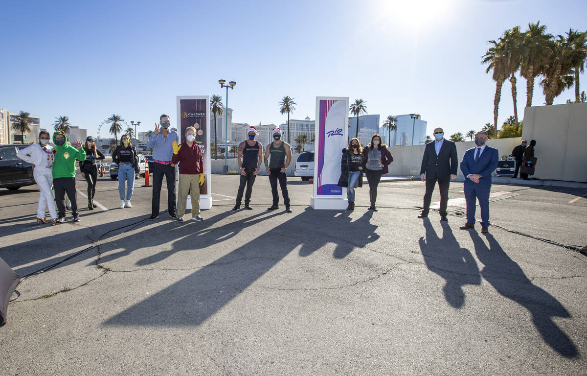 Performers and executives gather during the re-opening of the Rio on Tuesday, Dec. 22, 2020, in ...