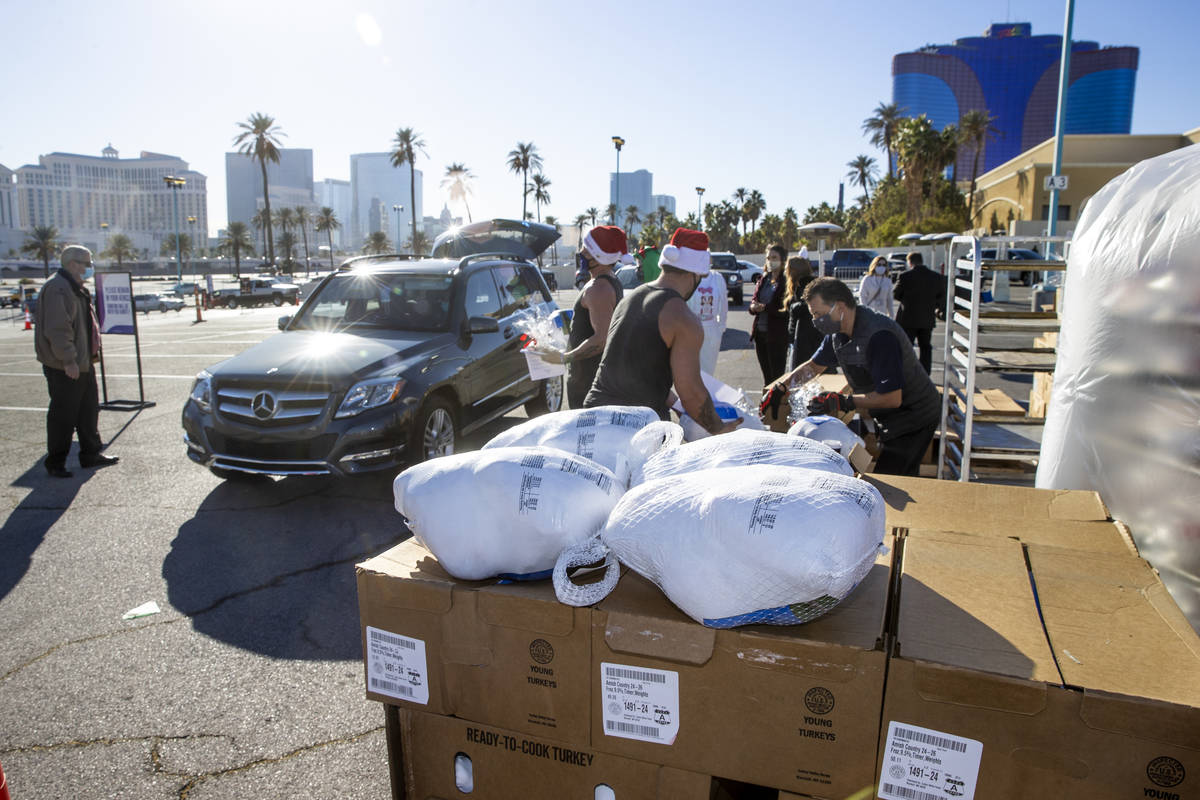 Chippendales members with Jade Simone and Piff the Magic Dragon deliver turkeys and cookies to ...