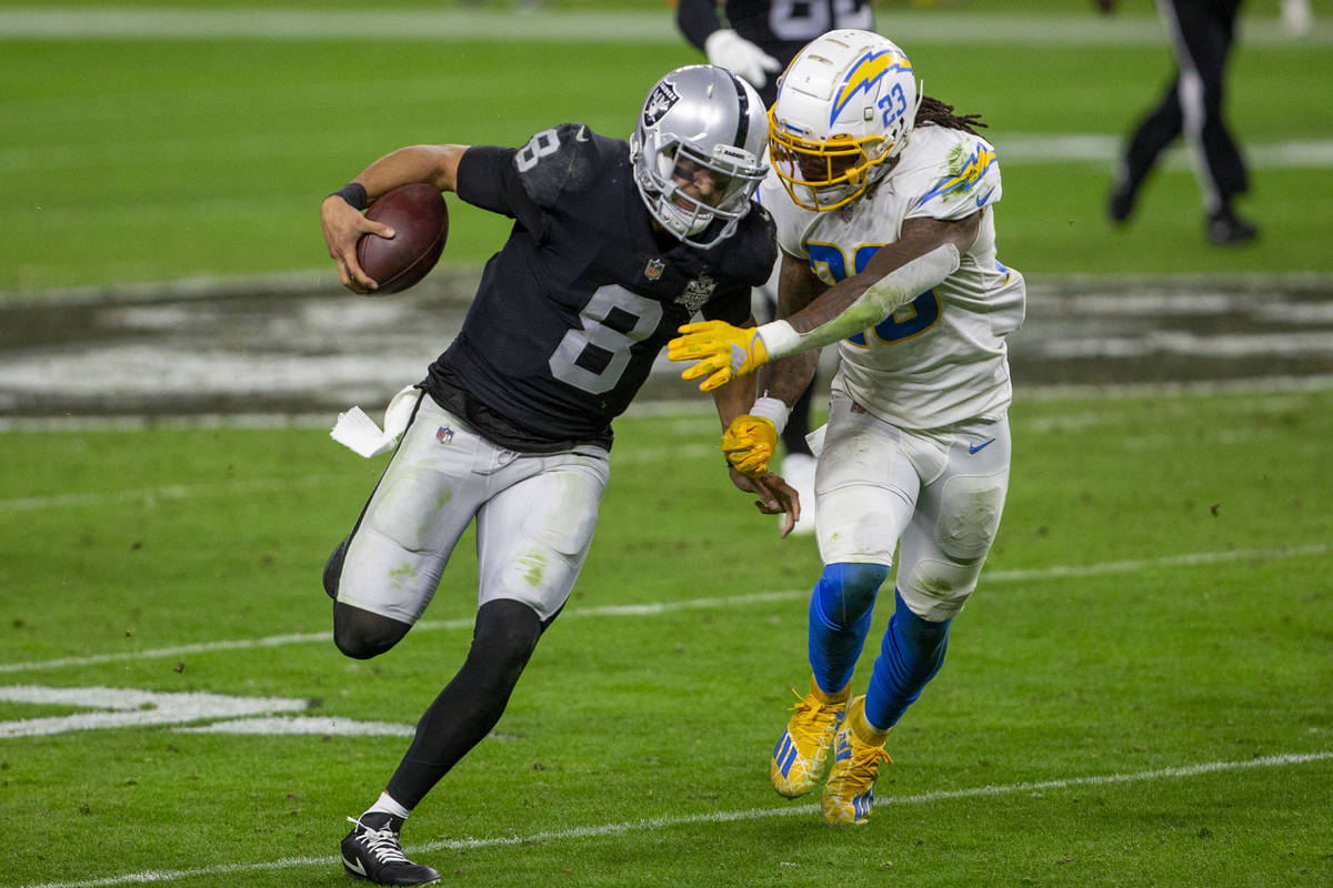 Raiders quarterback Marcus Mariota (8) runs with the football as Los Angeles Chargers strong sa ...