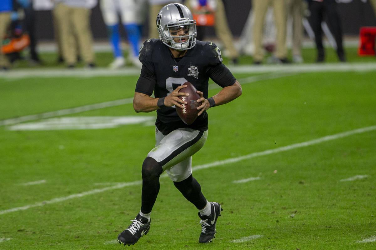 Raiders quarterback Marcus Mariota (8) runs with the football during the fourth quarter of an N ...