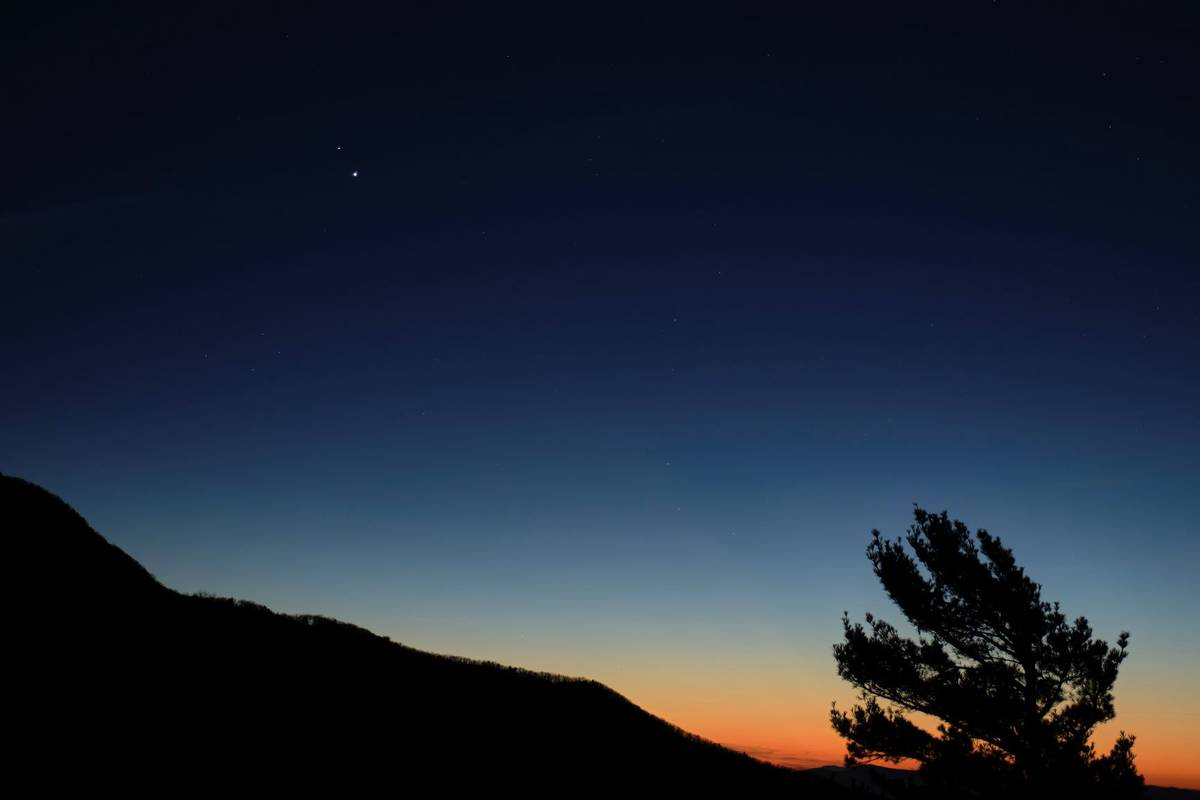 Saturn, top, and Jupiter, below, are seen after sunset from Shenandoah National Park in Luray, ...