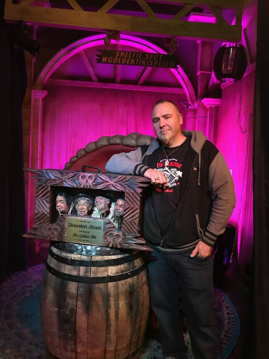 """Vegas wood-carving artist """"Billy The Crud"""" is shown with the """"Pawn Stars"""" shrunken heads after ..."""