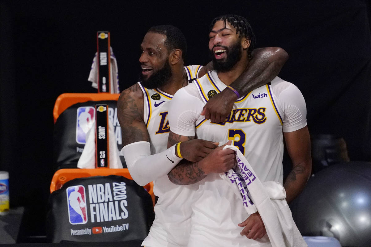 Los Angeles Lakers' LeBron James, rear, and Anthony Davis (3) celebrate after the Lakers defeat ...