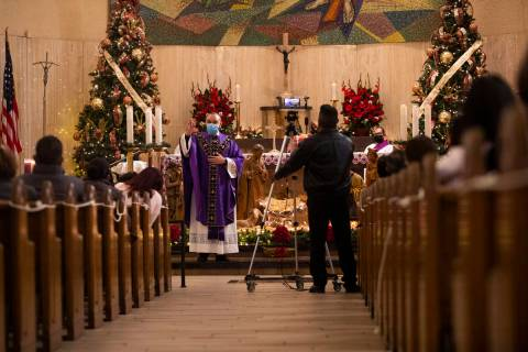 Father Miguel Corral delivers a sermon during Mass at St. Anne's Catholic Church in Las Vegas, ...
