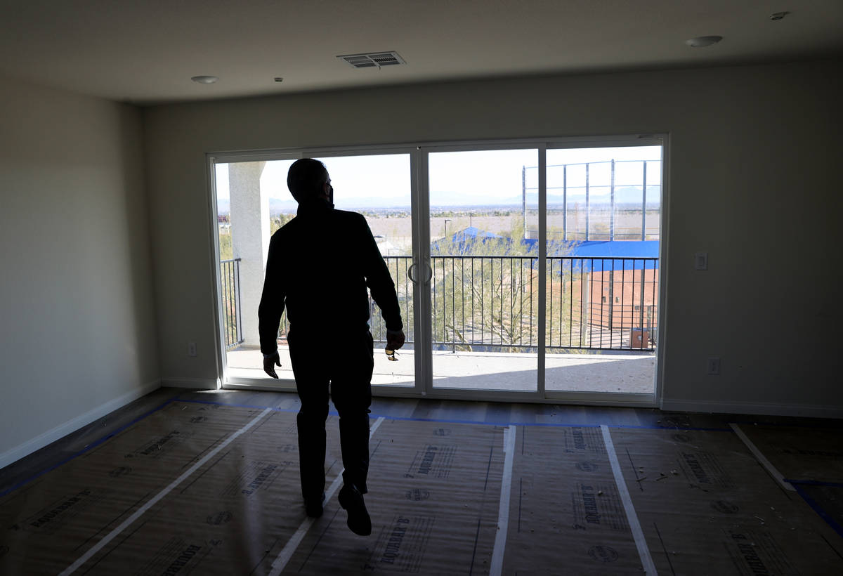 Tom McCormick, founder, Touchstone Living looks at the view of the Strip at his Panorama housin ...