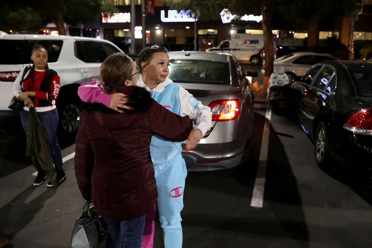 Unique Hairston, 36, cousin of Vinston Fortee Davis Jr., 26, hugs her mother Chris Hairston as ...