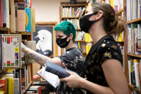 Friends Mercury Taft, left, and Stephanie Lehr, right, shop for books at Amber Unicorn Books. T ...