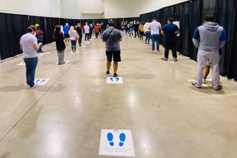 People wait in line for COVID-19 testing offered at Cashman Center on Nov. 18, 2020, in Las Veg ...