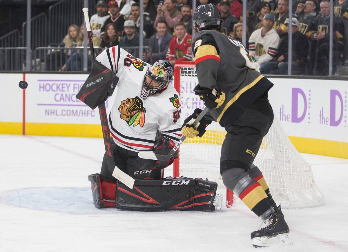 Vegas Golden Knights right wing Cody Glass (9) shoots on Chicago Blackhawks goaltender Corey Cr ...