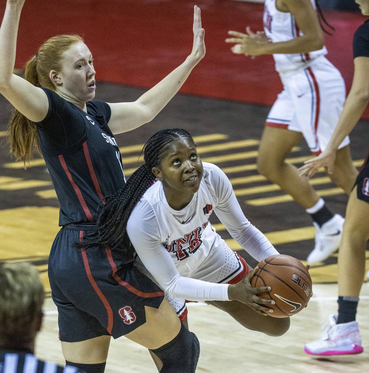 UNLV Lady Rebels forward Anna Blount (12, right) looks to the basket after getting past Stanfor ...