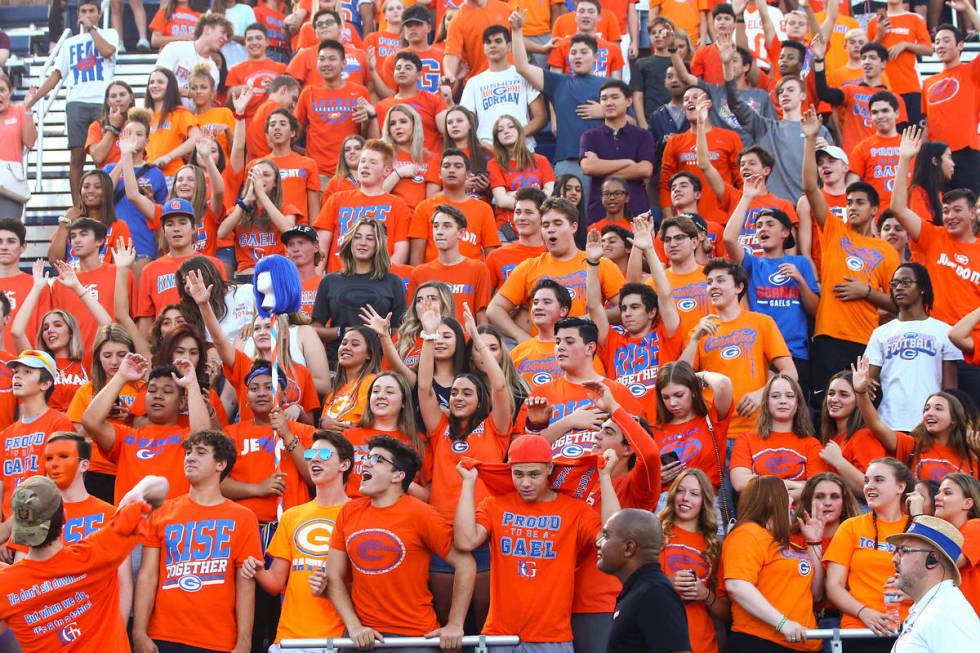 Bishop Gorman students cheer before the start of a football game against Orem at Bishop Gorman ...
