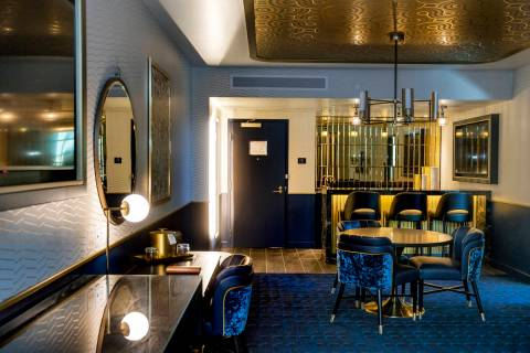 A comfortable living and retro bar area within the Circa End Suite at Circa on Friday, Dec. 18, ...