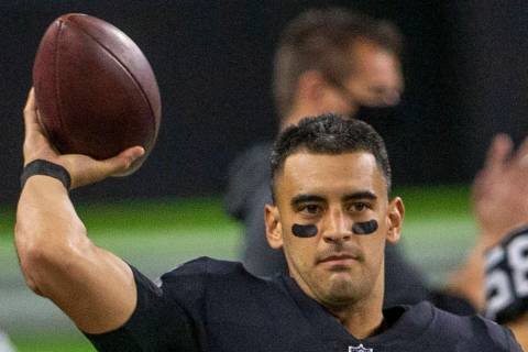 Raiders quarterback Marcus Mariota (8) warms up before entering the game against the Los Angele ...