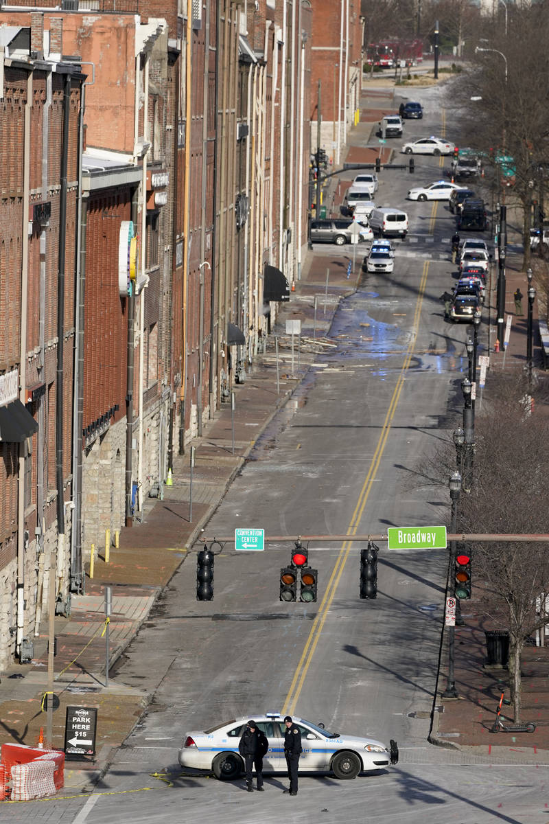Emergency personnel stand near the scene of an explosion in downtown Nashville, Tenn., Friday, ...