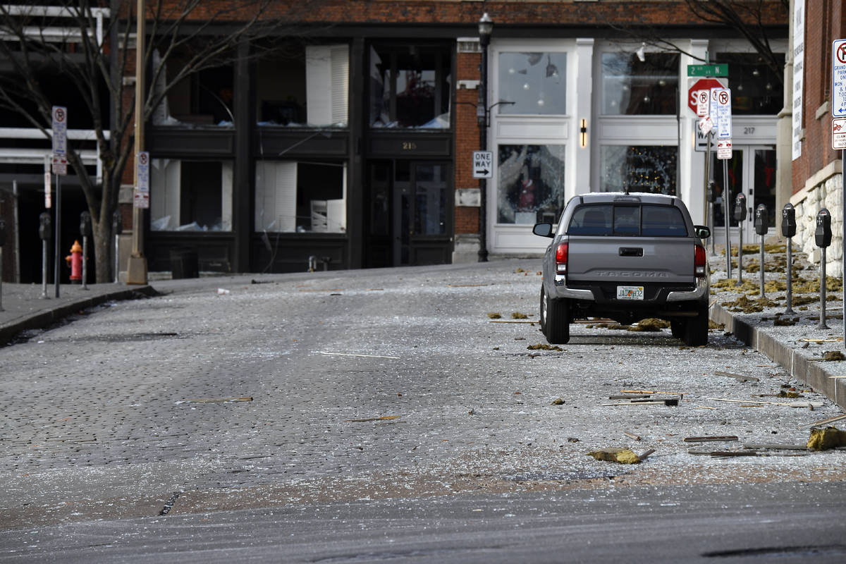 Glass from broken windows litters Bank Street at Second Avenue following the explosion in the a ...