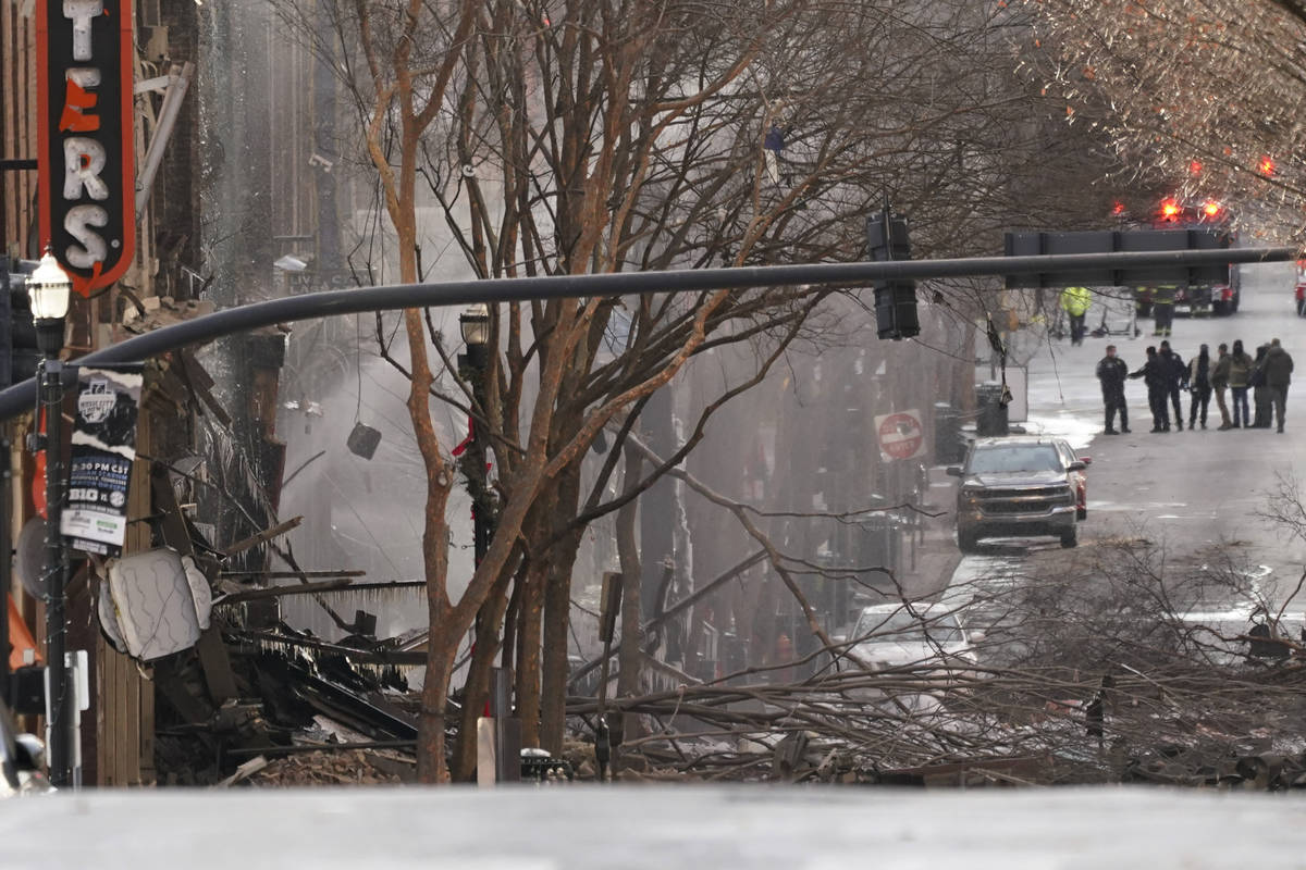 Emergency personnel work at the scene of an explosion in downtown Nashville, Tenn., Friday, Dec ...