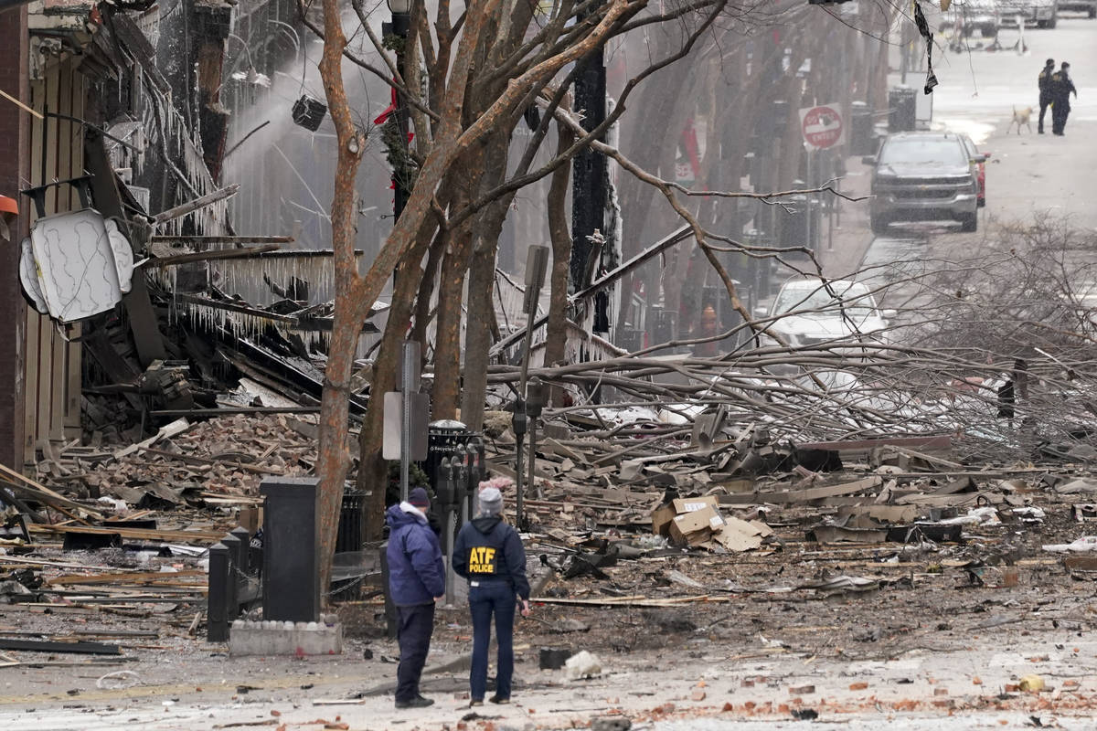Emergency personnel work near the scene of an explosion in downtown Nashville, Tenn., Friday, D ...