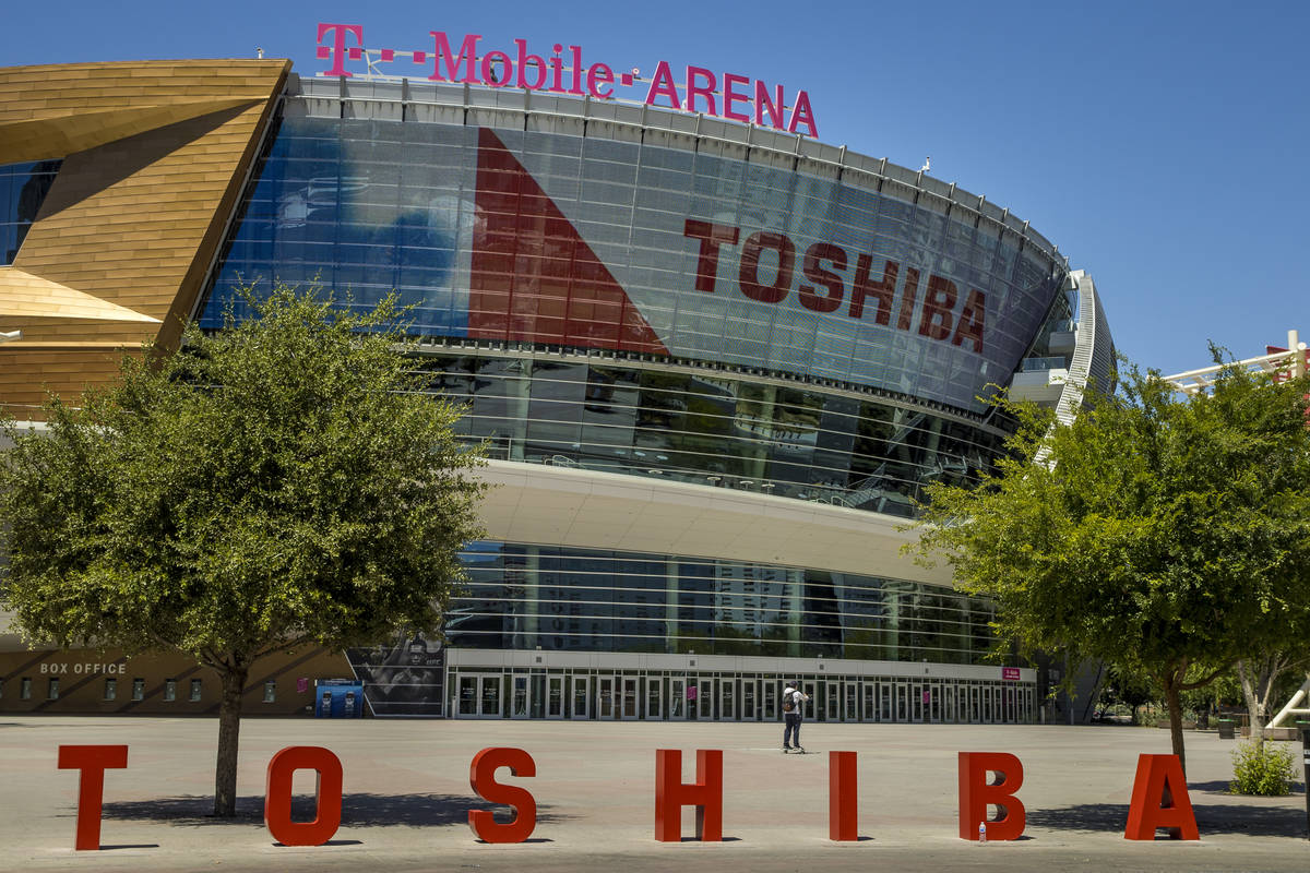 A pedestrian walks in front of the T-Mobile Arena a block off the Las Vegas Strip on Friday, Ma ...