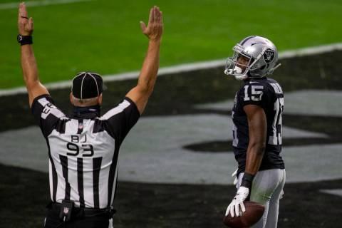 back judge Scott Helverson (93) signals touchdown after Raiders wide receiver Nelson Agholor (1 ...