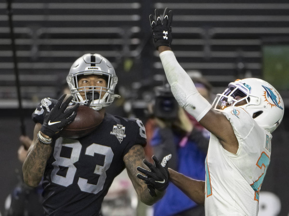 Raiders tight end Darren Waller (83) makes a one handed catch over Miami Dolphins free safety E ...