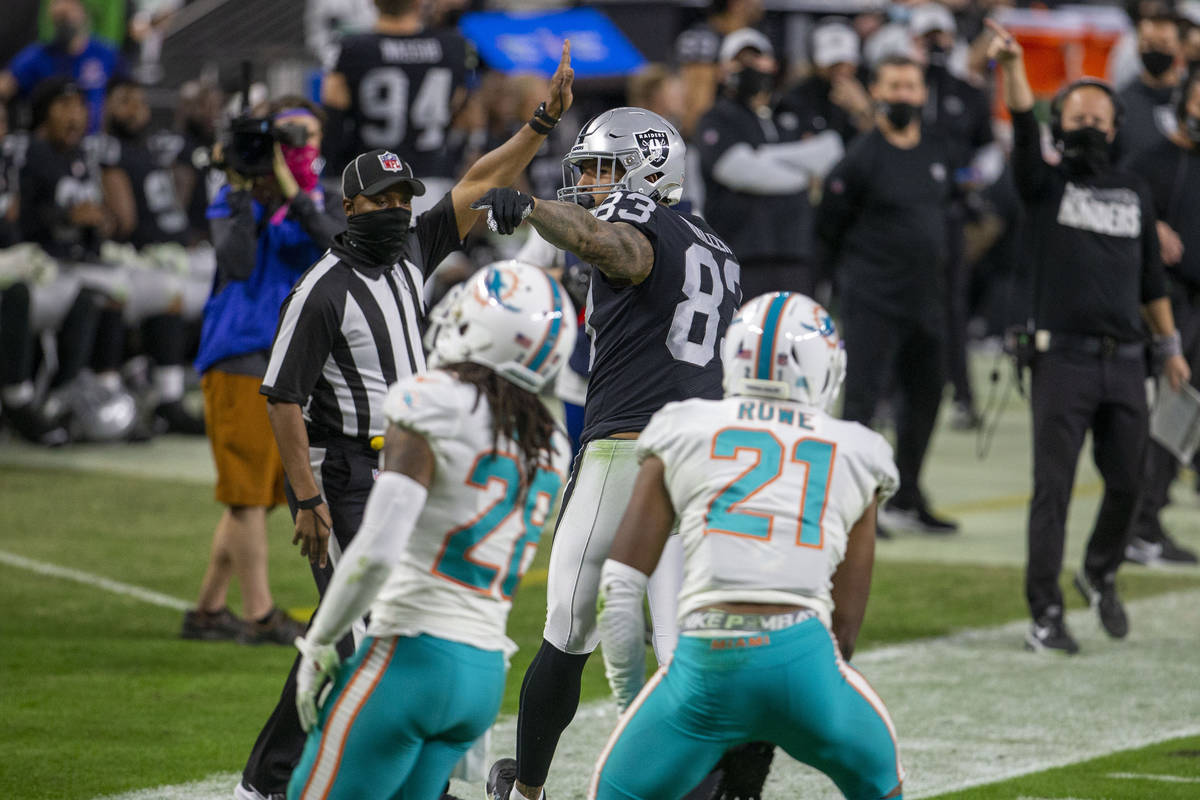 Raiders tight end Darren Waller (83) points for a first down after a catch made over Miami Dolp ...