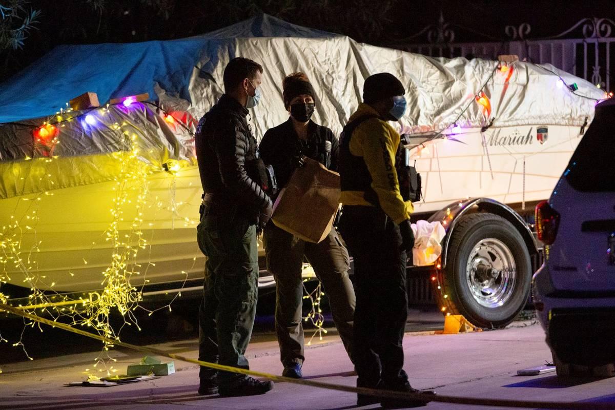 Metropolitan police investigate a homicide in the 4400 block of Bennett Drive on Sunday, Dec. 2 ...